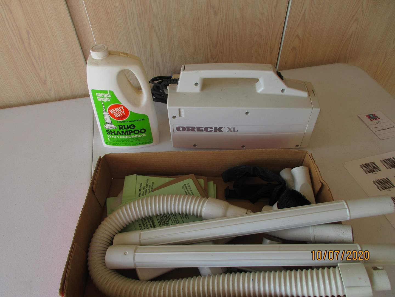 Lot # 109 - Oreck Vacuum + Rug Shampoo (main image)