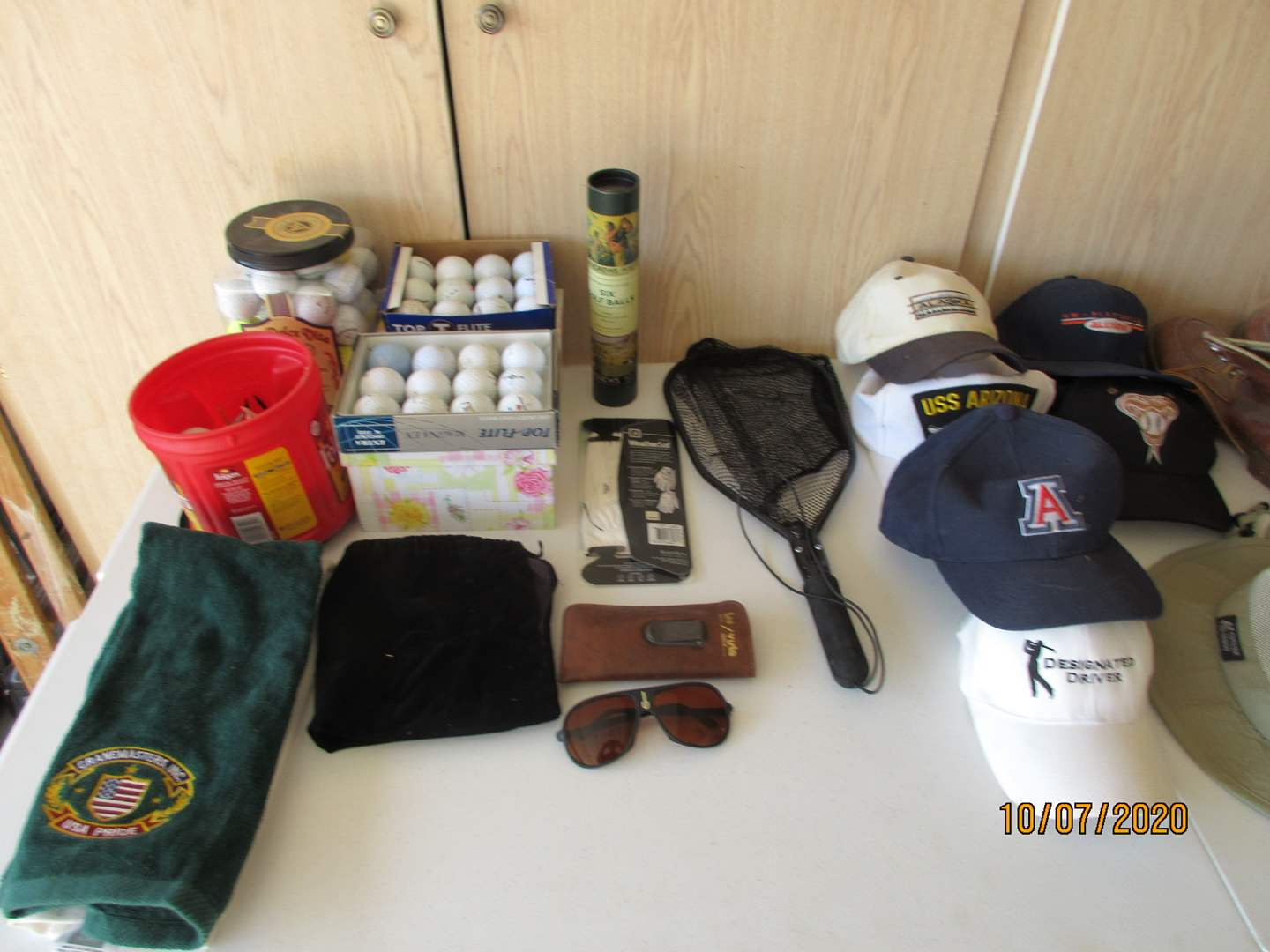 Lot # 129 - For the Golfer:  Balls, Shoes, Net, Hats ++ (main image)