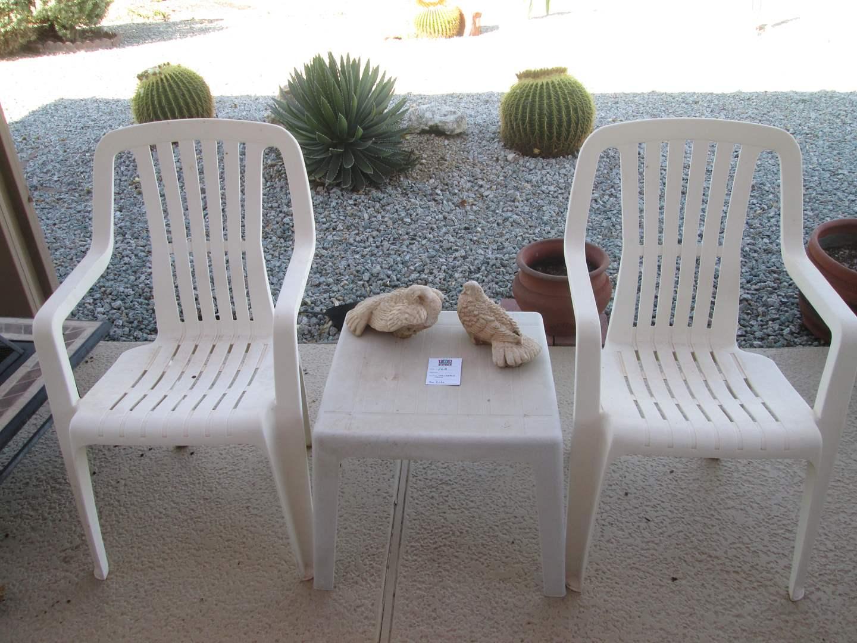 Lot # 168 - 2-Plastic Yard Chairs & Table + Yard Decor (main image)