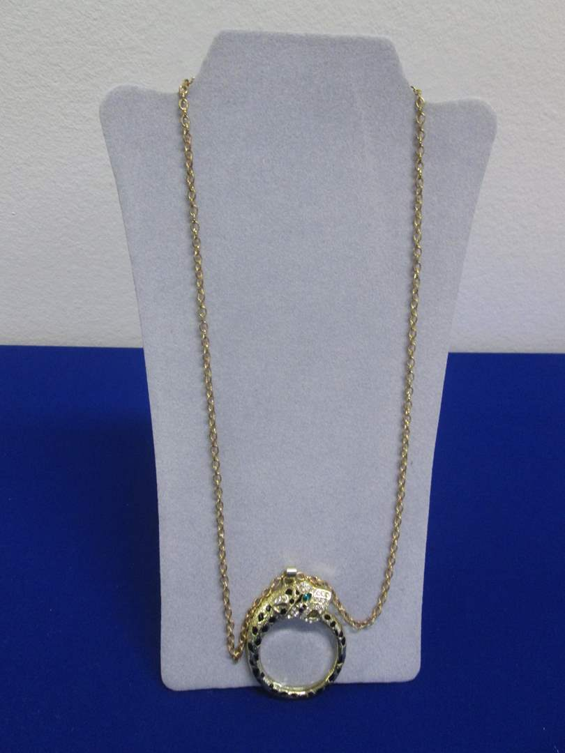 Lot # 140 - Costume Jewelry Magnifying Necklace (main image)