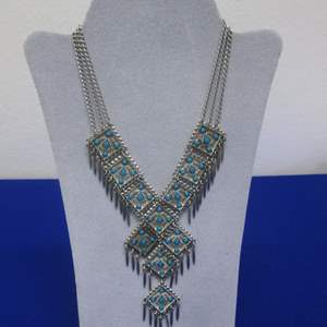 Lot # 151- Tribal Turquoise & Silver Colored Necklace