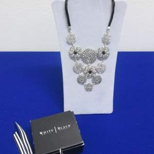 Lot # 141 - White/Black Brand Necklace