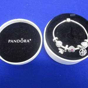Lot # 152 - Pandora Sterling Charm Bracelet 7 Charms