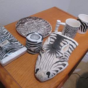 Lot # 90 - Zebra-Themed Party Ware; Mugs, Candle, Plates & Paper Goods