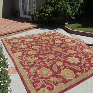 Lot # 3-Tan and burnt red area rug.