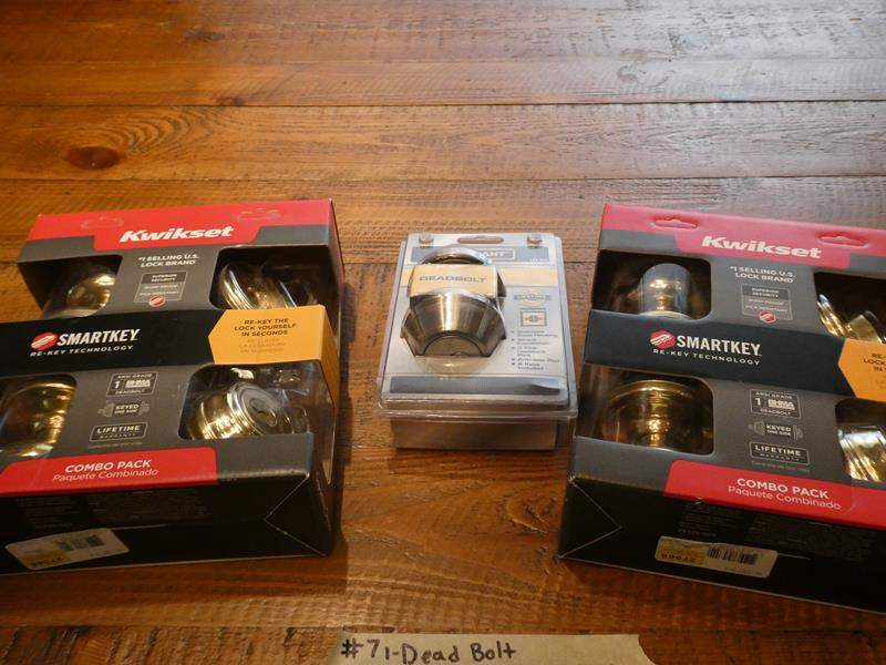 Lot # 7- Brand new dead bolt and 2 combo pack door knobs. Smartkey (main image)
