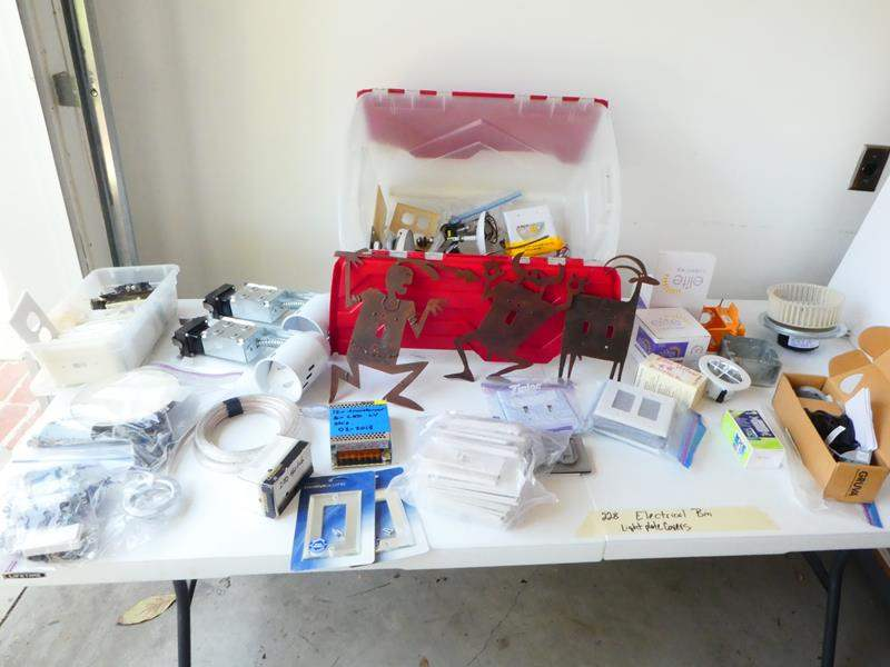 Lot # 228- Electrical bin- can lights, switches, decorative &  plate covers (main image)