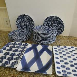 Lot # 19- Fun modern blue and white print plates with matching rectangle serving plates