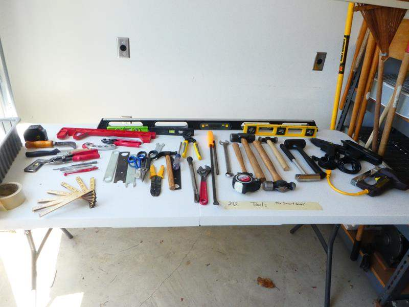 Lot # 242- TOOLS! Digital level and Tape, more tools (main image)