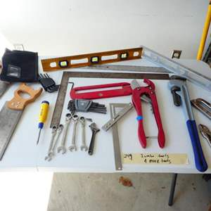 Lot # 249- Jumbo wrench and cutter. More amazing tools