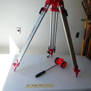 Lot # 251-Surveyor tripod and distance tracker.