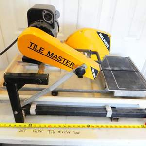Lot # 267- Felker tile master tile saw with stand! Normally over $1,000.00