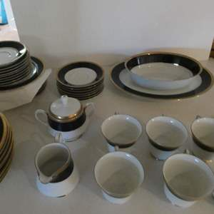 Lot # 43- Noritake China! Great condition! Very valuable. blue and Crete China with gold accents