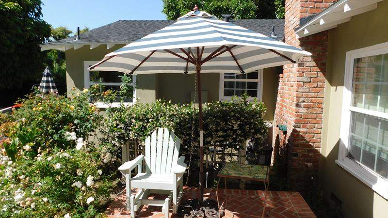 Lot # 361- Beautiful outside glider patio wood chair with umbrella and table! (main image)