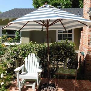 Lot # 361- Beautiful outside glider patio wood chair with umbrella and table!
