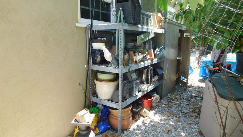 Lot # 375- This is a amazing metal rack full with everything you could ever imagine for your yard (main image)