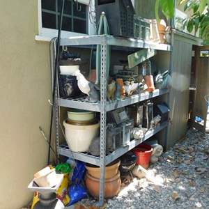 Lot # 375- This is a amazing metal rack full with everything you could ever imagine for your yard