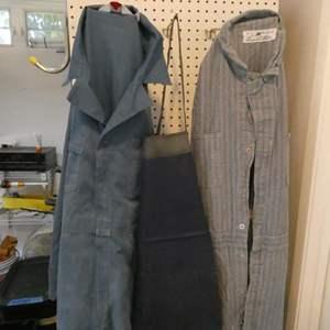 Lot # 296- Heavy duty jumpsuit, rubber boots & apron