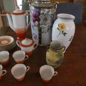 Lot # 77- Various collectors pieces. Orange china tea set.