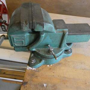 Lot # 303- Work bench , large VICE, content under bench