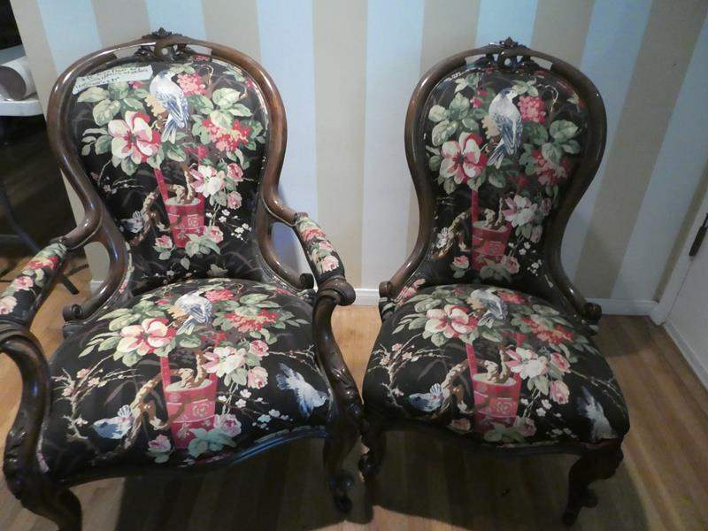 Lot # 95- vintage wing back floral chairs. sturdy and in great condition (main image)