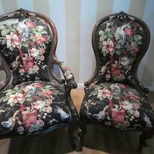 Lot # 95- vintage wing back floral chairs. sturdy and in great condition