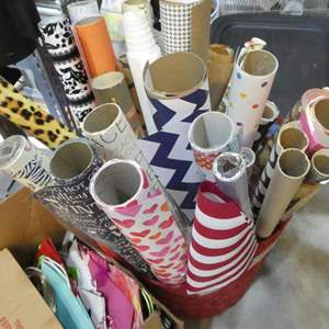 Lot # 339-  Huge lot of wrapping paper. Tubes and a box of wrapping bags