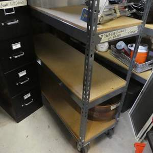 Lot # 346- Metal storage shelving. On Casters (No contents)