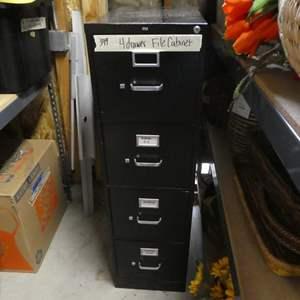 Lot # 349- Four drawer black file cabinet, metal