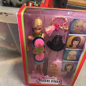 Lot # 352- 50th anniversary Barbie- new and in package, hot wheels,  and lots of other toys