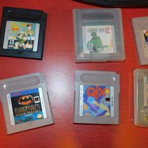 Lot # 389- Game boy color with assorted games and case