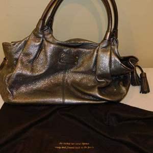 Lot # 397-Kate spade hand bag- like new, silver