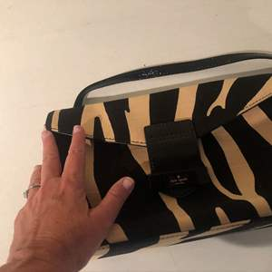 Lot # 403-You can never have enough hand bags, Kate spade, zebra hand bag