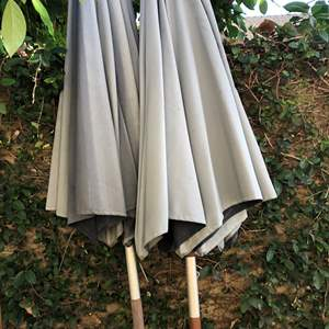 Lot # 524- 2 backyard umbrellas, 1 iron stand