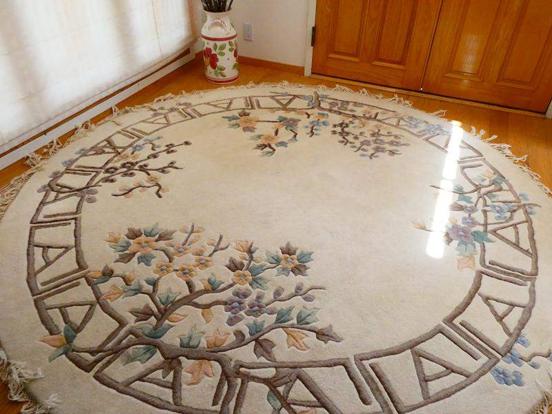 Lot # 2-Thick, round area rug with floral print (main image)