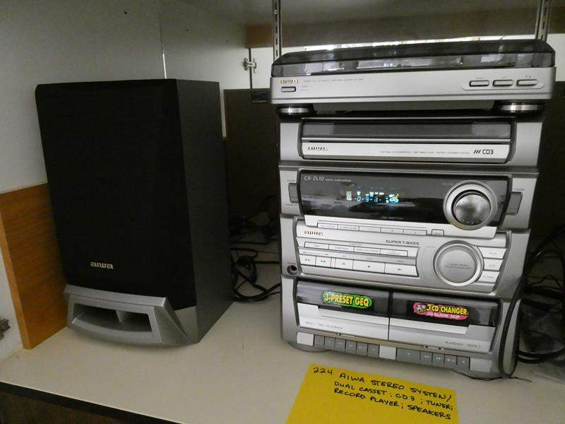 Lot # 224- Alwa stereo system/ dual cassette, cd3, tuner, record player and speakers (main image)