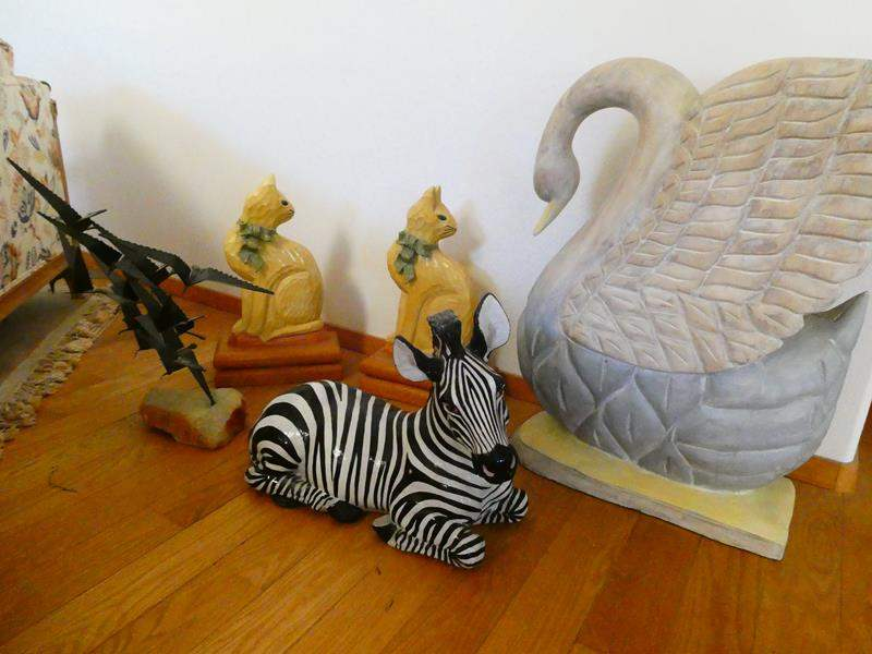 Lot # 17- Animal statues: Swan, zebra, cats, birds (main image)