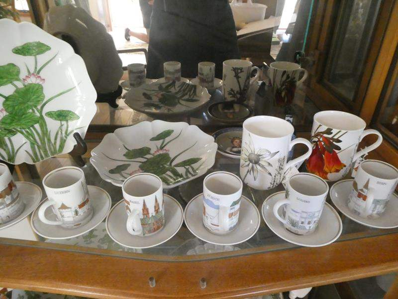 Lot # 18- Miscellaneous china. Mini tea cups and plates- from Switzerland, flower mugs (main image)
