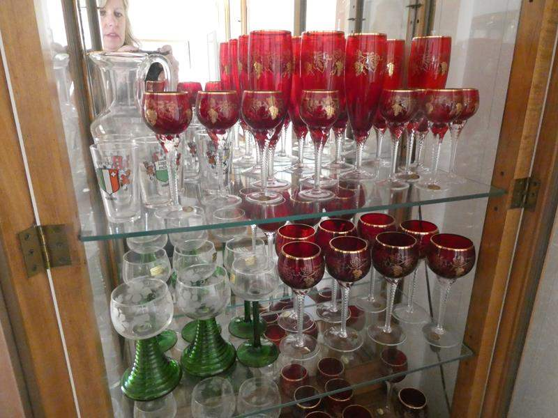 Lot # 27- Red and green depression glass and (silver or pewter) pitcher Wine glasses, variety of sizes. (main image)