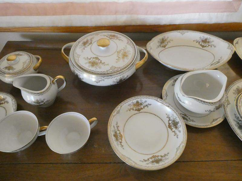 Lot # 32- Fine Meito china. Made in Japan, hand painted setting for 12 (main image)
