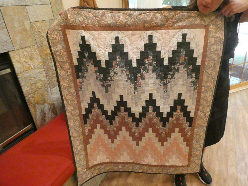 Lot # 45- two handmade quilts/ throws, smaller size (main image)