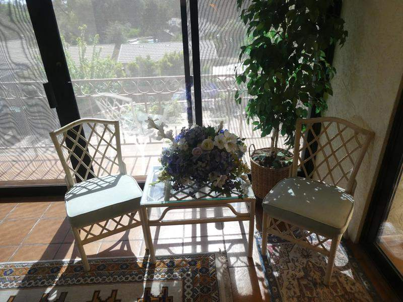Lot # 51- cute wood patio furniture with end table, plant and decorations (main image)