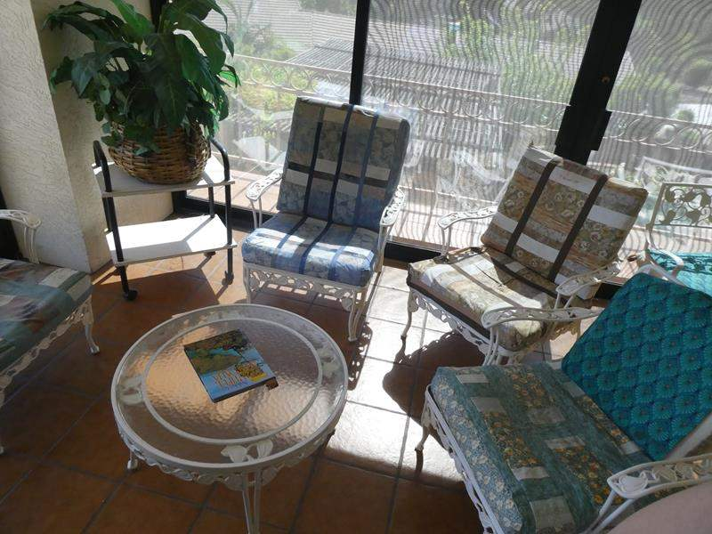 Lot # 54- Sturdy metal patio furniture, 4 chairs, 1 coffee table, plant, rolling shelf and fan (main image)