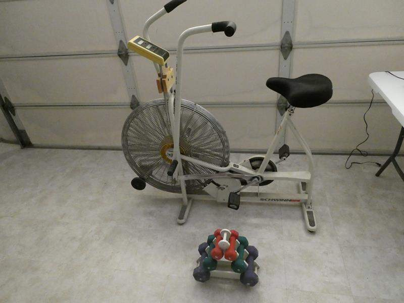 Lot # 258- GET FIT! Schwinn Airdyne exercise bike and wieghts (main image)