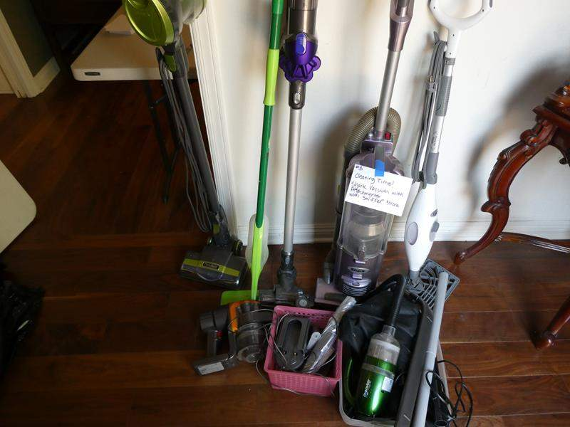 Lot # 3- Cleaning Time! Shark vacuum with attachments (used), Swiffer, and more! (main image)