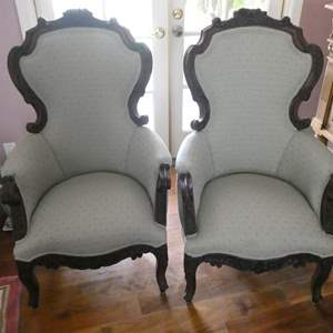 Lot # 110- Two vintage Victorian wing back chair.
