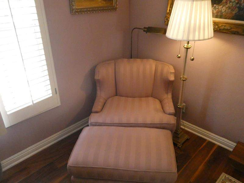Lot # 111-  Wing back Pink chair with ottoman and two lamps (main image)