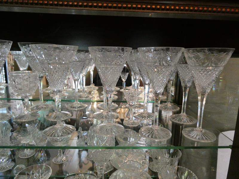 Lot # 9- So much crystal! Wine glasses, bowls, dishes and more! Two full shelves (main image)