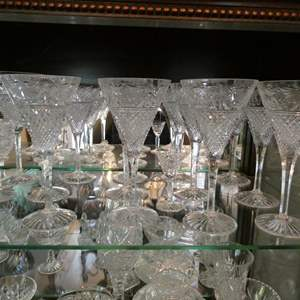Lot # 9- So much crystal! Wine glasses, bowls, dishes and more! Two full shelves