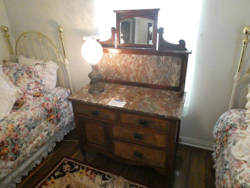 Lot # 114- Antique wood dresser with marble top and lamp (main image)